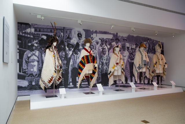 Portland Art Museum Exhibition, Restoring the Breath: Chief George and Willard Joseph robe along with apprentices robes, l-r Ang George, George/Joseph, Michelle Hebert, Raquel Joe, Kim Seward (photo credit: Portland Art Museum)